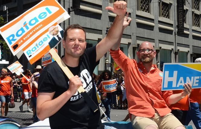 District 6 supervisor candidate Matt Haney, left, rode with District 8 Supervisor-elect Rafael Mandelman in Sunday's Pride parade. Photo: Rick Gerharter