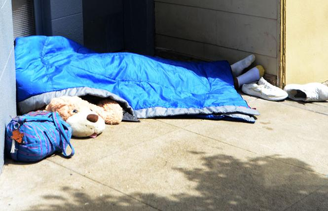 A man slept on a sidewalk in the Castro district in April. Photo: Rick Gerharter