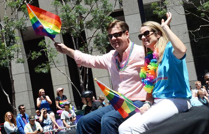 Mayor Mark Farrell, and his wife, Liz, wave to spectators as they ride in the San Francisco Pride parade June 24. Photo: Rick Gerharter