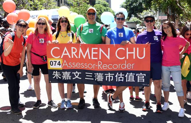 Assessor-Recorder Carmen Chu, far right, joined with friends at last month's San Francisco Pride parade. Photo: Courtesy Assessor-Recorder's office