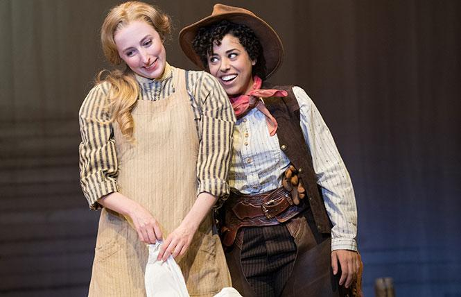 """Chicks and ducks and geese better scurry."" Curly (Tatiana Wechsler, right) tries to entice Laurey (Royer Bockus) into accompanying her to the box social. Photo: Jenny Graham, Oregon Shakespeare Festival"