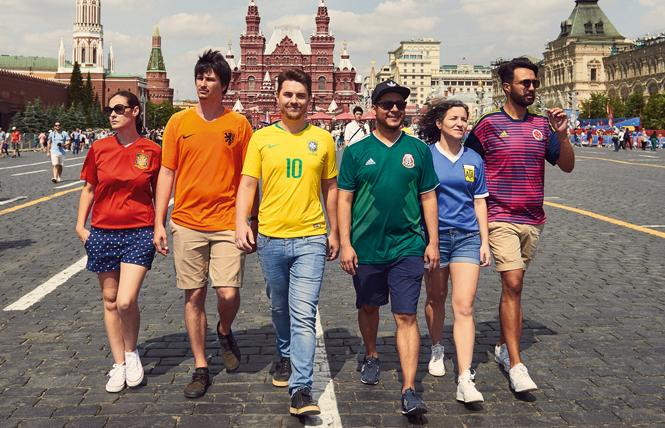 Hidden Flag activists wore soccer jerseys in the colors of the rainbow flag and protested Russia's anti-LGBT laws during the World Cup. Photo: http://www.thehiddenflag.org