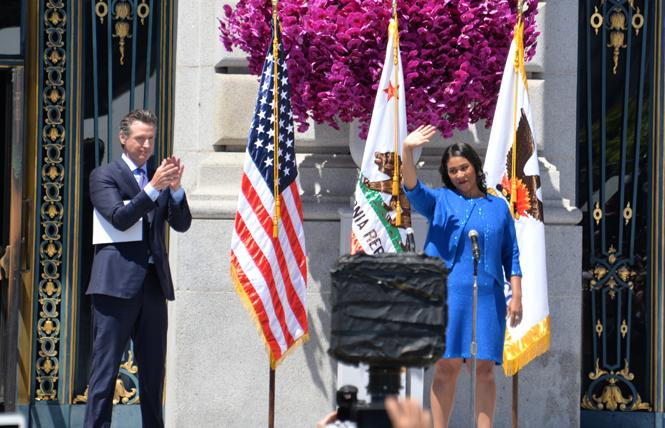 Lieutenant Governor Gavin Newsom congratulates London Breed, who he swore in as San Francisco's 45th mayor Wednesday, July 11. Photo: Bill Wilson