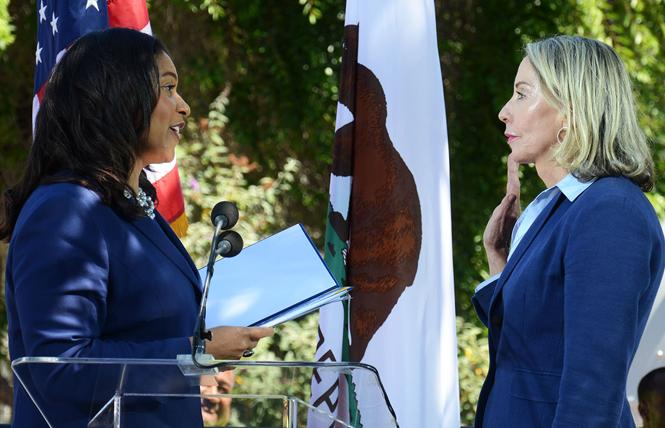 Mayor London Breed, left, swears in new District 5 Supervisor Vallie Brown Monday at Hayes Valley Playground. Photo: Rick Gerharter