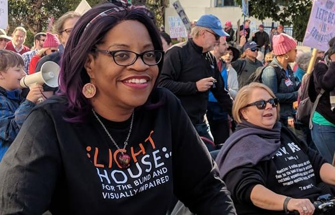 Queer disability advocate Robin Wilson-Beattie took part in the Oakland Women's March earlier this year. Photo: Benson Manica