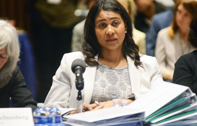 Amid a stack of binders, Mayor London Breed listens to recommendations from her policy transition committees during a summit Saturday at UC Hastings College of the Law. Photo: Rick Gerharter