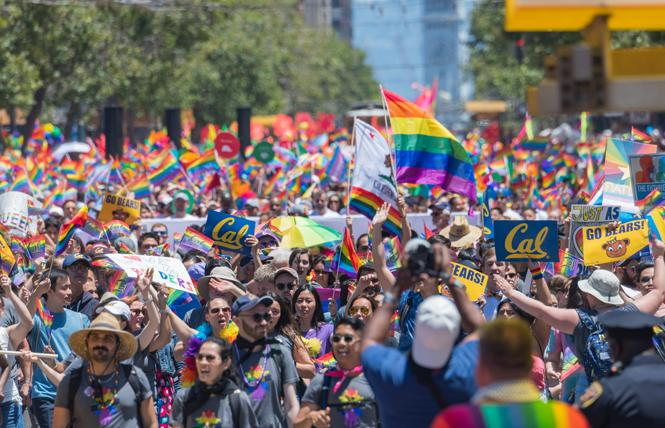 The UC Berkeley contingent carried rainbow flags during last month's San Francisco Pride parade. Photo: Jane Philomen Cleland