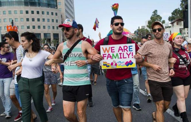 LGBT community members block a highway during a protest against a surrogate bill in Tel Aviv, Israel, Sunday, July 22. Photo: AP/Oded Balilty