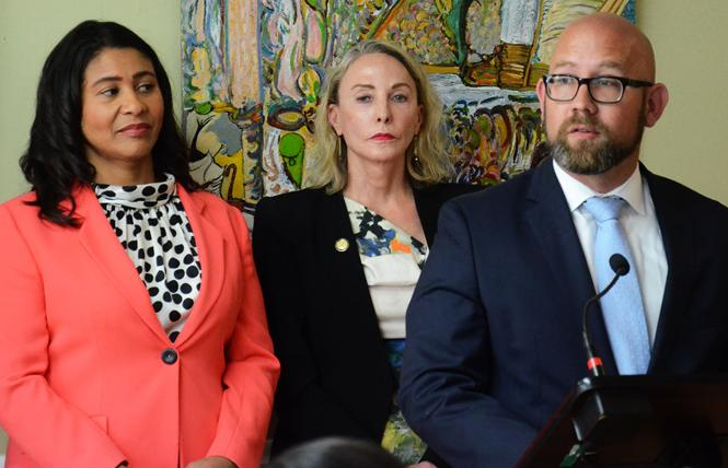 District 8 Supervisor Rafael Mandelman, right, spoke at a news conference Monday where Mayor London Breed, left, announced $1 million over two years for residential care facilities. Standing next to Breed is new District 5 Supervisor Vallie Brown. Photo: Rick Gerharter