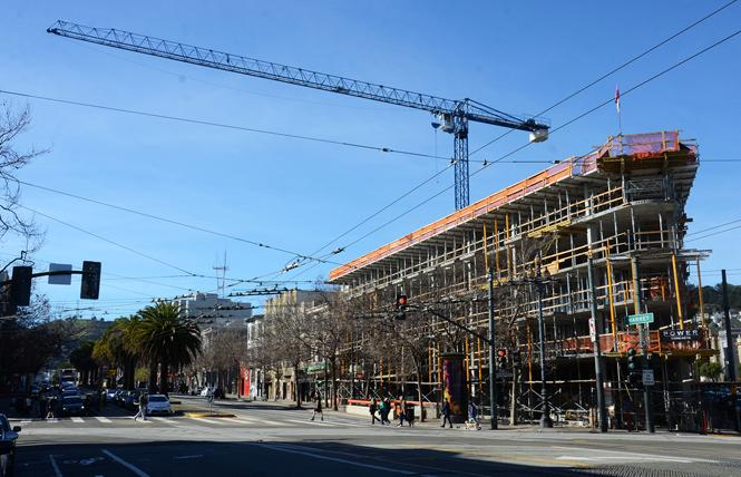 Construction continues on housing at the intersection of Church, Market and 14th streets. Photo: Rick Gerharter