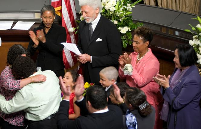 Oakland mayor Ron Dellums, center, looks on after officiating a same-sex couple's marriage in Oakland City Hall on June 16, 2008. He was joined by Congresswoman Barbara Lee (D-Oakland, second from right, and then-Oakland City Councilwoman Jean Quan, right. Photo: Lydia Gonzales