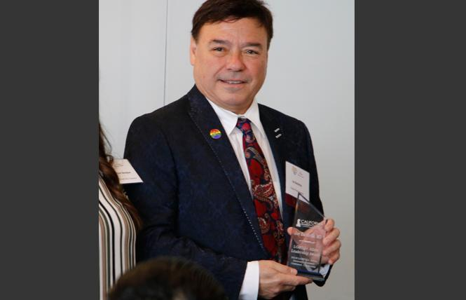 Dr. Jay Bachicha received his leadership award in June at a ceremony in Oakland. Photo: Courtesy Kaiser Permanente