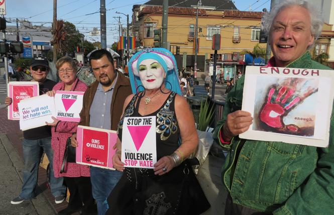 KDK Queen (Miss Chief), left, the Reverend Diana Wheeler, Leandro Gonzales, Sister Chola de Dah, and Paul Brown join in the weekly Companions of Dorothy the Worker Weekly Vigil: Stop the Violence in the Castro. Photo: Charlie Wagner