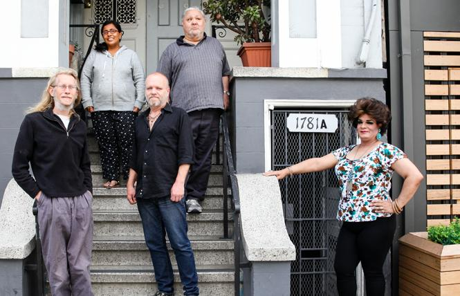 Donald Branchflower, aka Logos Branchflower, left, joined by Jennifer Emperador; William Carmichael, aka Lucille Carmichael; Richard Padilla, aka Renita Valdez; and Fredy Miranda, a.k.a. Alexis Miranda stand outside their longtime home, where the landlord is trying to evict them via the Ellis Act. Photo: Kelly Sullivan