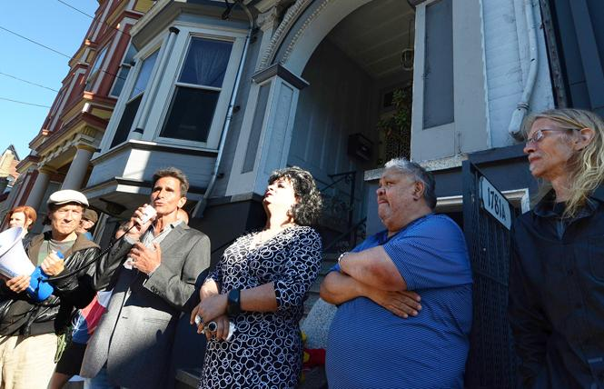Former state lawmaker Mark Leno spoke Monday in support of tenants threatened with an Ellis Act eviction on 15th Street. Tenant Fredy Miranda, aka Alexis Miranda, is to Leno's left. Photo: Rick Gerharter