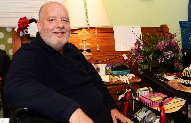 Gary Converse sits in his room at the Ellis Hotel. Photo: Rick Gerharter