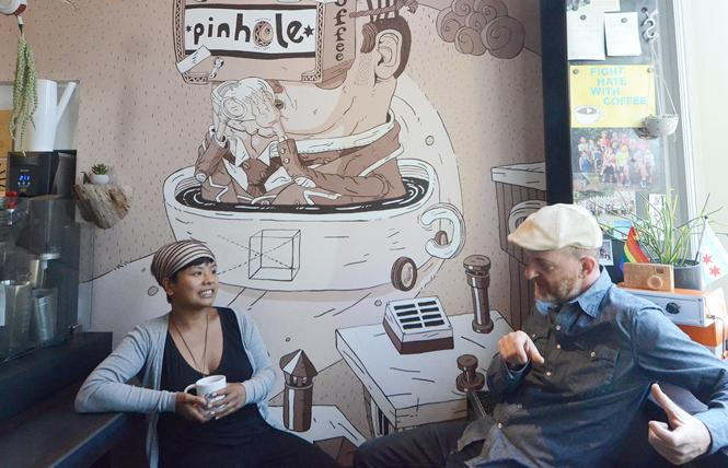 Pinhole Coffee owner JoEllen Depakakibo, left, chats with regular customer Dan Rosenfeld under a mural painted by Joey D, Depakakibo's brother, in honor of their father, Jose. Photo: Rick Gerharter