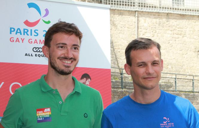 Joel Deumier, left, president of SOS Homophobie, talked with France's LGBT expert Frederic Potier at Gay Games X. Photo: Heather Cassell