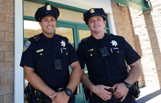 San Francisco police Officers Paul McIntosh, left, and David Boyle, prepare to head out to walk the beat on Castro Street Monday, August 6. Photo: Rick Gerharter