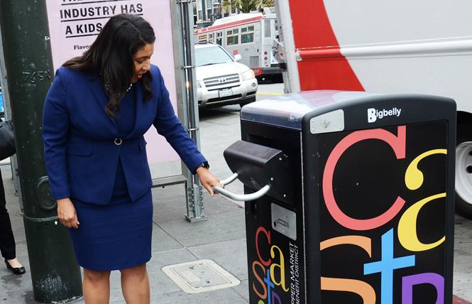 Mayor London Breed checks out the Bigbelly trash can on Castro Street during her unannounced walk around the neighborhood Monday. Photo: Rick Gerharter