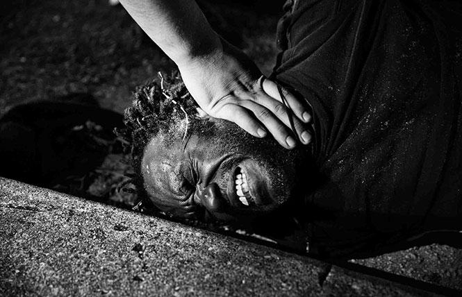 "Paolo Pellegrin, ""Police detain an intoxicated, deaf, and mute man in Liberty City. Miami, Florida, USA, 2012."" Photo: Paolo Pellegrin/Magnum Photos, courtesy the artist"