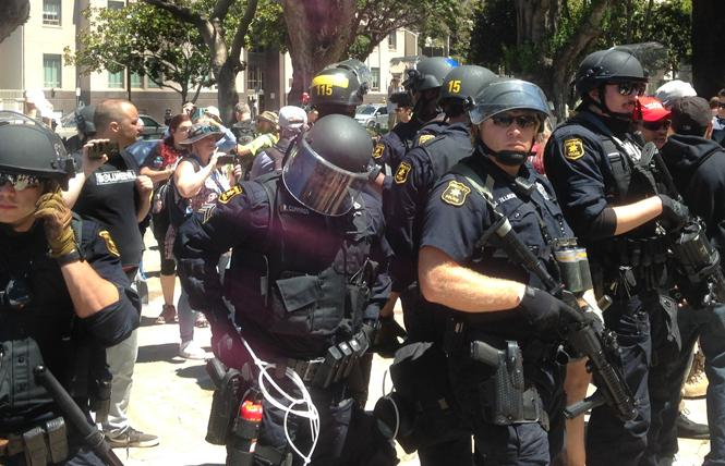 Berkeley police in riot gear form a perimeter around fascist and anti-Marxist demonstrators in Martin Luther King Jr. Civic Center Park on August 5. Photo: Christina A. DiEdoardo