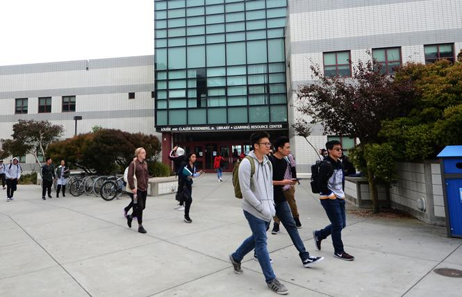 Students walk pass the Rosenberg Library on the main campus of City College of San Francisco. Photo: Rick Gerharter