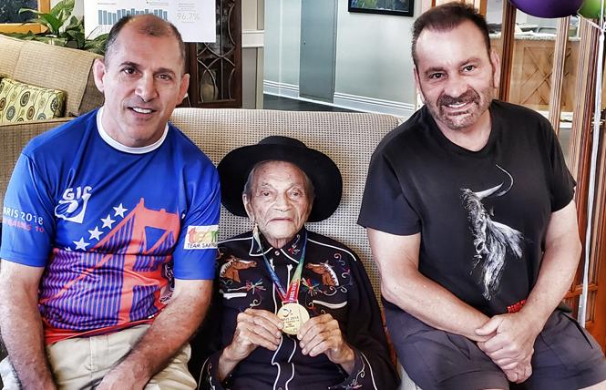 Paul Mart, center, recently celebrated his 100th birthday and was joined by Gay Games wrestlers Steve Pezzoli, left, and Gene Dermody. Photo: Courtesy Gene Dermody.