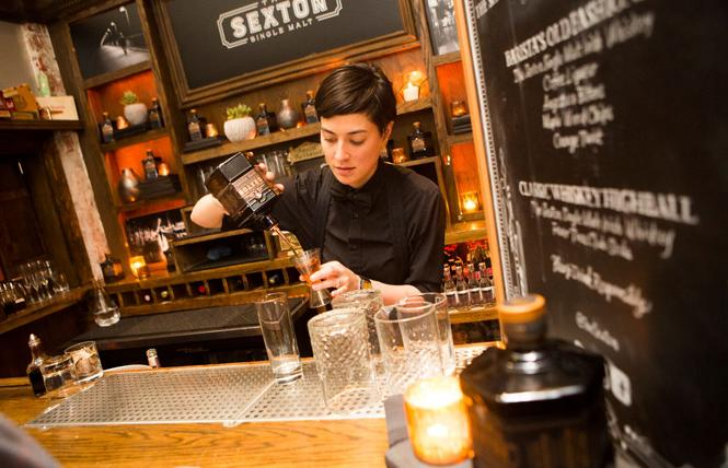 A bartender mixes a cocktail at Sexton.