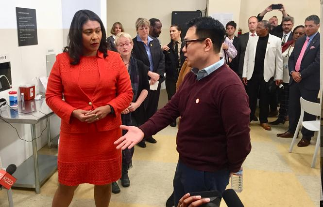 Mayor London Breed toured the Safer Inside demonstration project Wednesday with Glide clinical director Dr. Kenneth Kim. Photo: Liz Highleyman