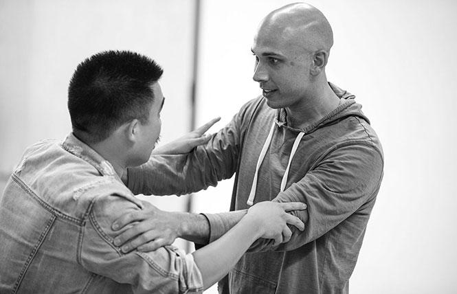 "Phil Wong (Youssif/Daniel) and Wiley Naman Strasser (Ahmed/Martin) in a rehearsal for Shotgun Players' ""Kiss."" Photo: Cheshire Isaacs"