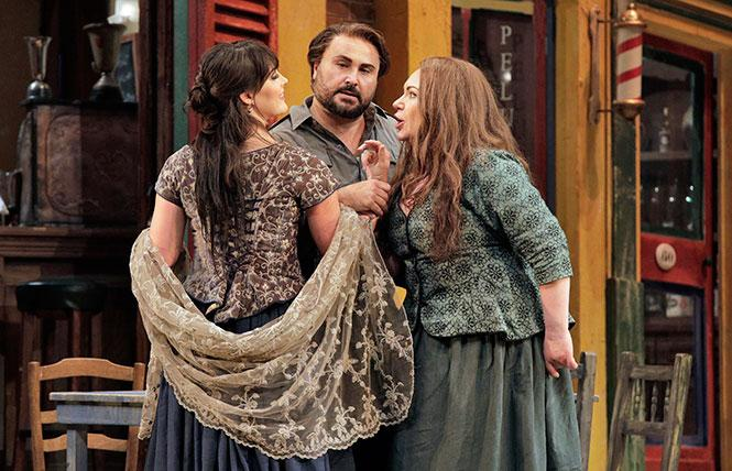 "Laura Krumm as Lola, Roberto Aronica as Turiddu, and Ekaterina Semenchuk as Santuzza in Mascagni's ""Cavalleria Rusticana."" Photo: Cory Weaver/San Francisco Opera"