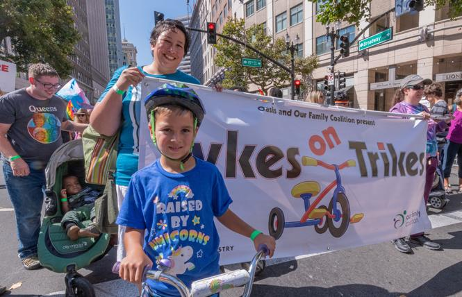 Tadeo Ramos-Grima, 6, joined mom Josie Ramos-Grima in the Tykes on Trikes contingent at the Oakland Pride parade September 9. Photo: Jane Philomen Cleland