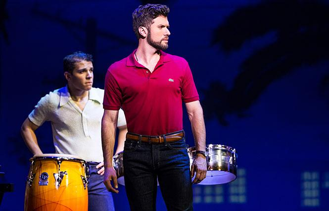 "Mauricio Martinez as Emilio Estefan (with Adriel Flete, background) in ""On Your Feet!,"" now playing the SHN Golden Gate Theatre in San Francisco. Photo: Matthew Murphy"