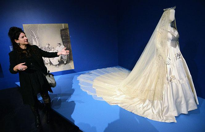 "Efrat Assaf-Shapira, curator from the Israel Museum in Jerusalem, speaks about how a white wedding dress became the custom in Western societies during a tour of ""Veiled Meanings: Fashioning Jewish Dress,"" now at the Contemporary Jewish Museum in San Francisco. Photo: Rick Gerharter"