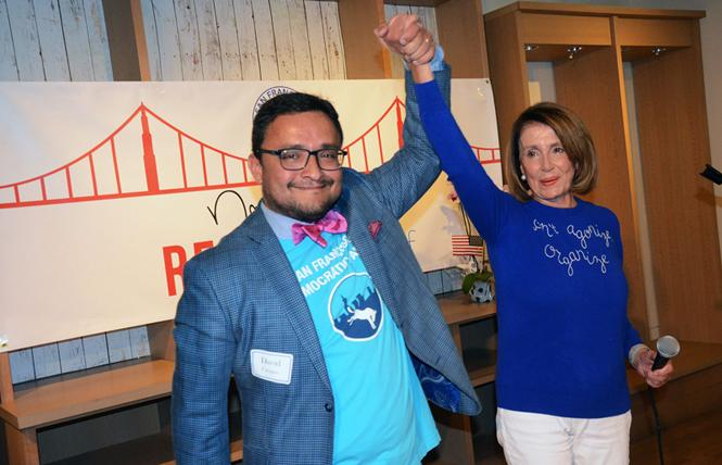 David Campos, chair of the San Francisco Democratic Party, and House Minority Leader Nancy Pelosi gave a victory cheer Saturday, as the Democratic Party opened its call center for the November midterm elections. Photo: Rick Gerharter