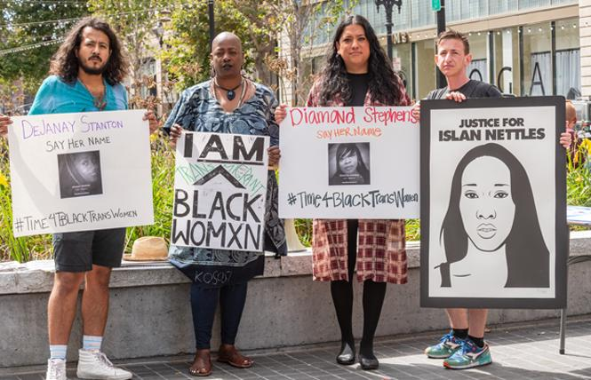 The Transgender Law Center held a moment of silence Friday, September 14, for black transgender women who have been killed this year in the U.S. Nicolas Gonzalez Medina, left, joined gallery owner Ashara Ekundayo, TLC's Isa Noyola, and Micah Bazant, a trans artist with Forward Together in downtown Oakland. Photo: Jane Philomen Cleland