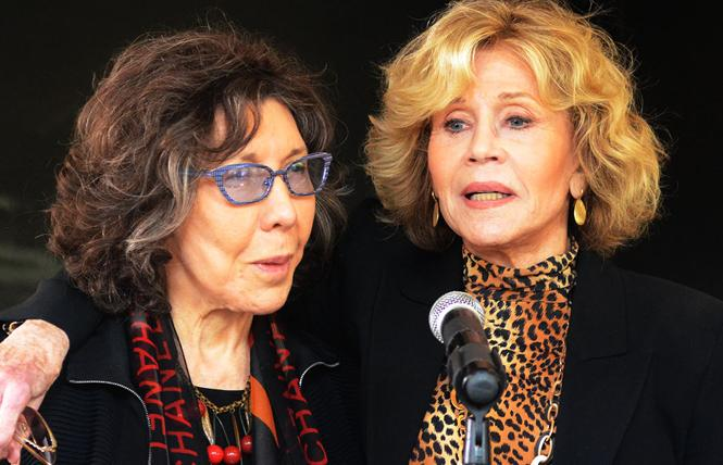 Lily Tomlin, left, and Jane Fonda spoke in San Francisco Friday in support of the One Fair Wage campaign, which would apply the minimum wage to both tipped and non-tipped workers. Photo: Rick Gerharter