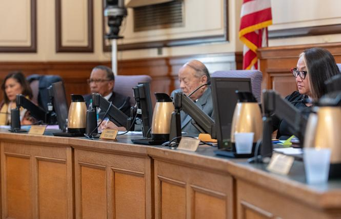 San Francisco health commissioners, including Cecilia Chung, right, listen to public comment about the next health director during a meeting Tuesday. Photo: Jane Philomen Cleland