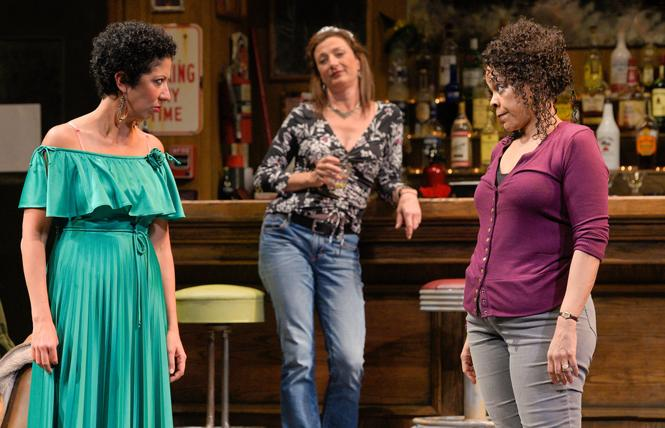 "Jessie (Sarah Nina Hayon) and Cynthia (Tonye Patano) discuss the rumors that their positions could be outsourced to Mexico in Lynn Nottage's 2017 Pulitzer Prize-winning drama ""Sweat,"" playing A.C.T.'s Geary Theater. Background: Tracey (Lise Bruneau). Photo: Kevin Berne"