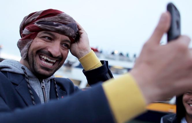 "Gay Iraqi Ghazwan Alsharif of ""From Baghdad to the Bay"" enjoys his freedom wearing an American flag turban. Photo: Courtesy ""From Baghdad to the Bay"""