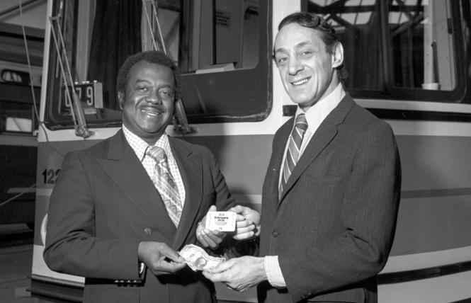 Muni General Manager Curtis Green, left, shows off the new Muni Fast Pass with Supervisor Harvey Milk on February 2, 1978. Photo: Courtesy SFMTA Photo Archive