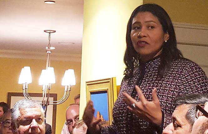San Francisco Mayor London Breed, shown standing on a small table speaking to LGBT community leaders Monday, October 22, has declined to attend a trip to Montgomery, Alabama for a U.S. Conference of Mayors event. Photo: Cynthia Laird