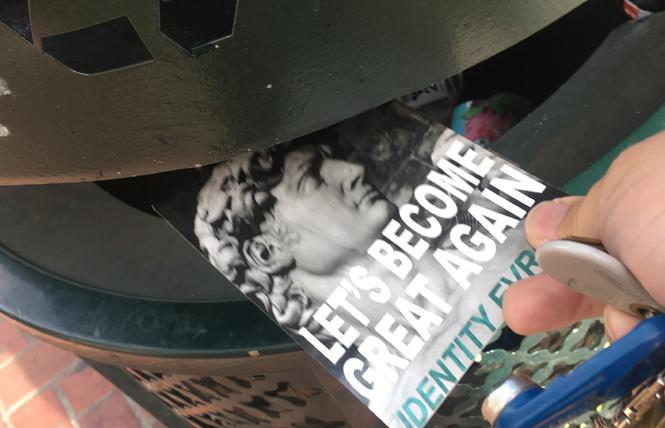 A flyer from the white supremacist group Identity Evropa posted directly across from Twitter's Market Street headquarters is trashed Sunday, October 28, a day after what the Anti-Defamation League called the bloodiest attack on Jews in American history took place in Pittsburgh, Pennsylvania. Photo: Christina A. DiEdoardo
