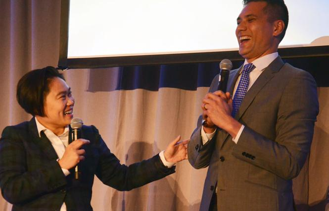 Former San Francisco Pride board president Michelle Meow, left, shared a laugh with ABC-TV anchor Reggie Aqui as they co-hosted PRC's recent Mighty Real Gala. Photo: Rick Gerharter