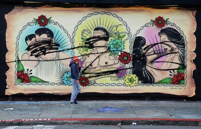 Galería de la Raza, which is now threatened with eviction, has also faced anti-LGBT actions during its history. In June 2015, a gay-themed mural on the Bryant Street exterior wall of the gallery was tagged with black spray paint. Photo: Rick Gerharter