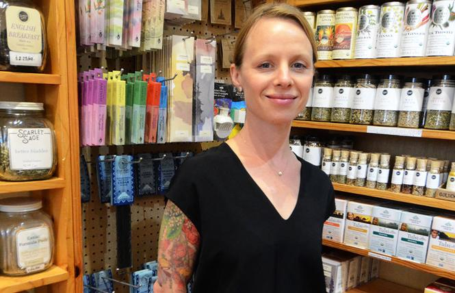 Scarlet Sage owner Laura Ash stands amid various herbal products in her shop. Photo: Rick Gerharter