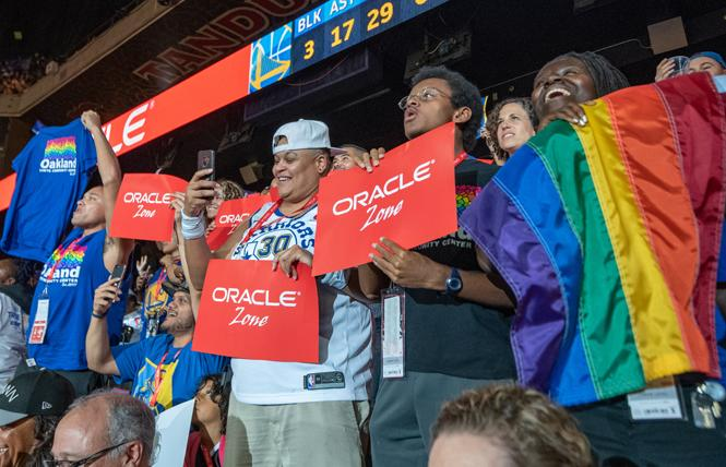 Supporters of the Oakland LGBTQ Community Center showed their spirit at the Golden State Warriors' Pride Night game Friday, November 2. Photo: Jane Philomen Cleland