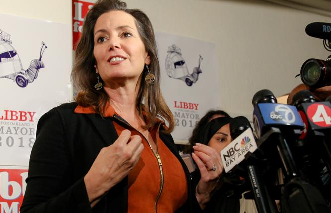 Oakland Mayor Libby Schaaf speaks to reporters Tuesday night. Photo: Kelly Sullivan