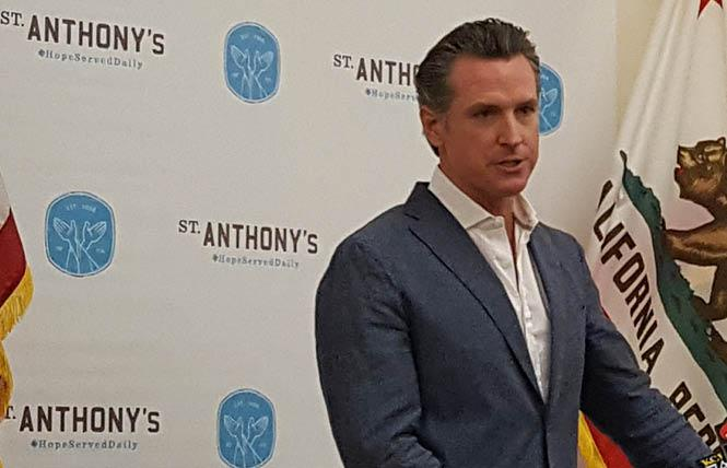 Governor-elect Gavin Newsom spoke to reporters at a news conference at the St. Anthony's Foundation Thursday. Photo: Cynthia Laird
